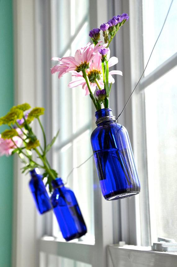 Repurpose wine bottle hanging vases fashionfoodfeminism for Wine bottle flower vase